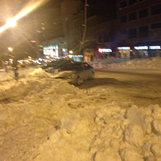3 cars on King St getting towed.
